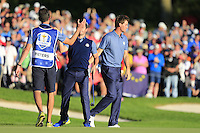 Rory McIlroy (NIR) Team Europe celebrates with Thomas Pieters (BEL) on the 16th during the Friday afternoon fourball at the Ryder Cup, Hazeltine national Golf Club, Chaska, Minnesota, USA.  30/09/2016<br /> Picture: Golffile | Fran Caffrey<br /> <br /> <br /> All photo usage must carry mandatory copyright credit (&copy; Golffile | Fran Caffrey)