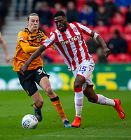 7th March 2020; Bet365 Stadium, Stoke, Staffordshire, England; English Championship Football, Stoke City versus Hull City; Bruno Martins Indi of Stoke City is tackled by Jackson Irvine of Hull City
