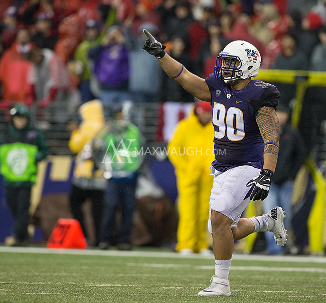 Taniela Tupou celebrates his forced fumble, which the Huskies recovered.