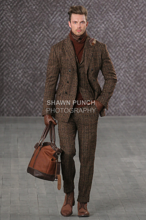 """Model walks runway in an outfit from the Joseph Abboud Fall Winter 2016 """"American Savile Row"""" men's collection, during New York Fashion Week Men's Fall 2016."""