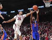 NWA Democrat-Gazette/J.T. WAMPLER Arkansas' Reggie Chaney and Florida's Kevarrius Hayes vie for a rebound Wednesday Jan. 9, 2019 at Bud Walton Arena in Fayetteville.