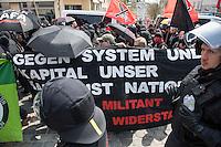 """Ca. 1000 Nazis aus ganz Deutschland marschierten am Sonntag den 1. Mai 2016 im Saeschsichen Plauen auf. Die Naziorganisation 3.Weg hatte den Marsch angemeldet. Etliche Nazis waren dabei vermummt und zeigten auch den Hitlergruss, die Polizei schritt jedoch nicht ein.<br /> Nach der Haelfte der Marschroute beendeten die Nazis ihre Demonstration, da die Polizei die Marschroute verkuerzen wollte. Sie forderten die Polizei auf den Weg freizugeben. Danach griffen Aufmarschteilnehmer die Polizei an, die daraufhin Wasserwerfer, Pfefferspray, Traenengas und Schlagstoecke einsetzte. Mehrere Gruppen Nazis zogen danach durch Plauen und jagten Menschen.<br /> Nach einer Stunde bekamen die Nazis einen erneuten Aufmarsch von der Polizei genehmigt und zogen zurueck zum Bahnhof.<br /> Im Bild: Der sog. """"Antikapitalistische Block"""" der Nazi-Demonstration. Die Nazis kopieren die Art, das Auftreten, die Vermummung, die Transparente, Symbole und die Parolen linker Demonstrationen und benutzen sie mit nationalistischen Inhalten.<br /> 1.5.2016, Plauen<br /> Copyright: Christian-Ditsch.de<br /> [Inhaltsveraendernde Manipulation des Fotos nur nach ausdruecklicher Genehmigung des Fotografen. Vereinbarungen ueber Abtretung von Persoenlichkeitsrechten/Model Release der abgebildeten Person/Personen liegen nicht vor. NO MODEL RELEASE! Nur fuer Redaktionelle Zwecke. Don't publish without copyright Christian-Ditsch.de, Veroeffentlichung nur mit Fotografennennung, sowie gegen Honorar, MwSt. und Beleg. Konto: I N G - D i B a, IBAN DE58500105175400192269, BIC INGDDEFFXXX, Kontakt: post@christian-ditsch.de<br /> Bei der Bearbeitung der Dateiinformationen darf die Urheberkennzeichnung in den EXIF- und  IPTC-Daten nicht entfernt werden, diese sind in digitalen Medien nach §95c UrhG rechtlich geschuetzt. Der Urhebervermerk wird gemaess §13 UrhG verlangt.]"""