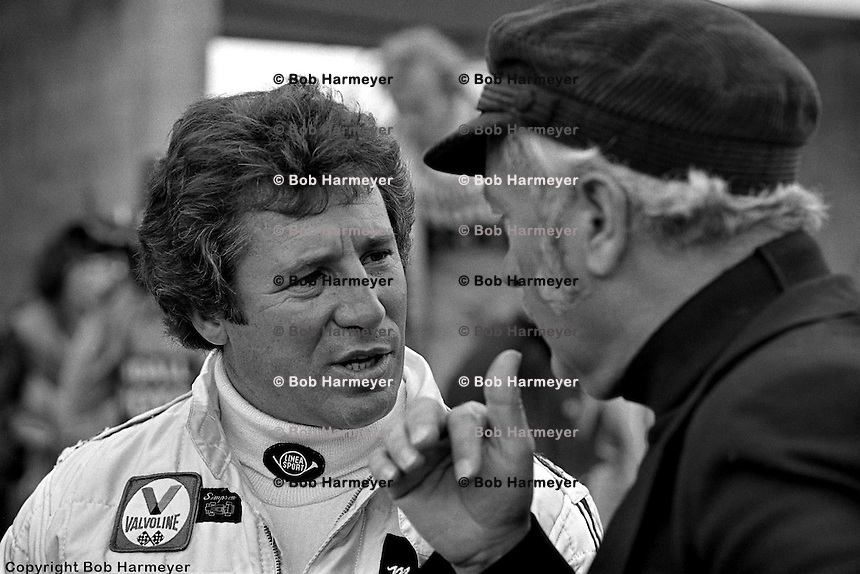 WATKINS GLEN, NY - OCTOBER 1978: Mario Andretti, left, speaks with Colin Chapman during practice for the Formula 1 race at Watkins Glen International on October 1, 1978 at Watkins Glen, NY.