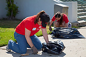 Keller Williams volunteers help clean up at John Adams Middle School in Santa Monica. More than 30,000 associates from <br /> Keller Williams Realty across the United States and Canada participate in the third annual RED Day, May 12, 2011. RED Day, which stands for Renew, Energize and Donate,  is a collective service initiative where the company's associates donate a day to give back to the community. Santa Monica, California, USA