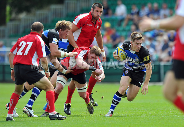 Tom Heathcote breaks through the London Welsh defence. Pre-season friendly match, between Bath Rugby and London Welsh on August 11, 2012 at the Recreation Ground in Bath, England. Photo by: Patrick Khachfe / Onside Images