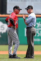 Indianapolis Indians manager Dean Treanor #27 argues a balk call with first base umpire Will Little during a game against the Buffalo Bisons at Coca-Cola Field on May 22, 2012 in Buffalo, New York.  Indianapolis defeated Buffalo 6-3.  (Mike Janes/Four Seam Images)