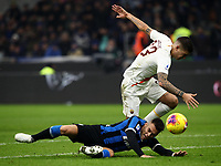 Calcio, Serie A: Inter Milano - AS Roma, Giuseppe Meazza stadium, December 6, 2019.<br /> Inter's Lautaro Martinez (l) in action with Roma's Gianluca Mancini (r) during the Italian Serie A football match between Inter and Roma at Giuseppe Meazza (San Siro) stadium, on December 6, 2019.<br /> UPDATE IMAGES PRESS/Isabella Bonotto