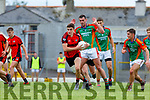 Sean O'Shea Kenmare drives past Shane O'Sullivan Mid Kerry during their SFC quarter final in Fitzgerald Stadium on Sunday