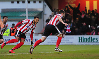 Lincoln City's Lee Frecklington, right, celebrates scoring his sides equalising goal to make the score 1-1 with team-mate Matt Green<br /> <br /> Photographer Chris Vaughan/CameraSport<br /> <br /> The EFL Sky Bet League Two - Lincoln City v Notts County - Saturday 13th January 2018 - Sincil Bank - Lincoln<br /> <br /> World Copyright &copy; 2018 CameraSport. All rights reserved. 43 Linden Ave. Countesthorpe. Leicester. England. LE8 5PG - Tel: +44 (0) 116 277 4147 - admin@camerasport.com - www.camerasport.com