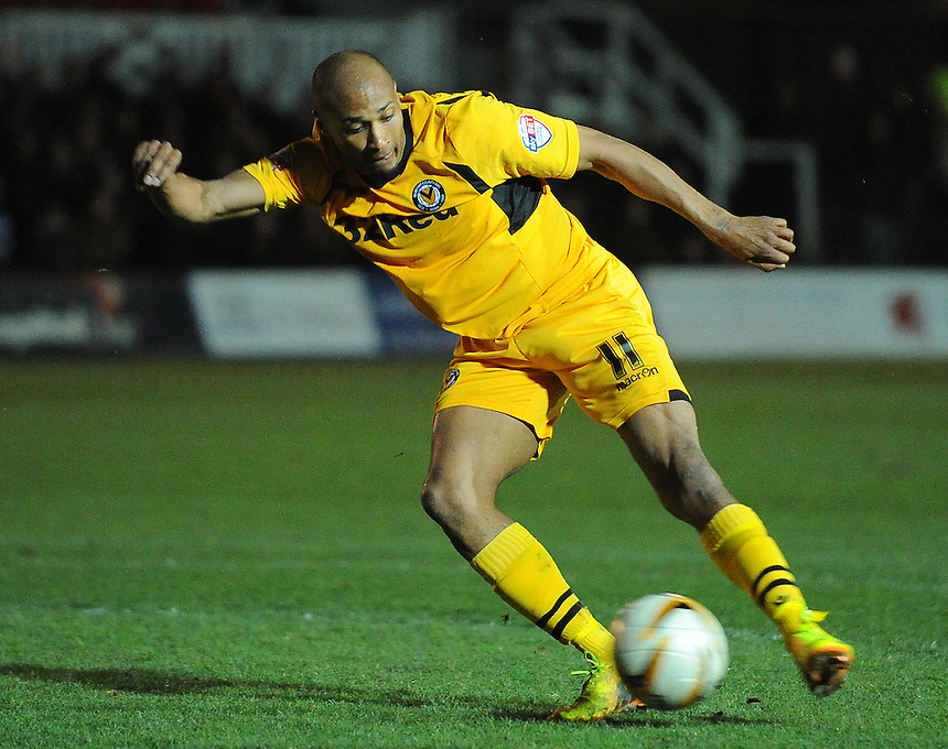 Newport County's Chris Zebroski takes a shot<br /> <br /> Photo by Kevin Barnes/CameraSport<br /> <br /> Football - The Football League Sky Bet League Two - Newport County AFC v Dagenham &amp; Redbridge - Wednesday 19th March 2014 - Rodney Parade - Newport<br /> <br /> &copy; CameraSport - 43 Linden Ave. Countesthorpe. Leicester. England. LE8 5PG - Tel: +44 (0) 116 277 4147 - admin@camerasport.com - www.camerasport.com