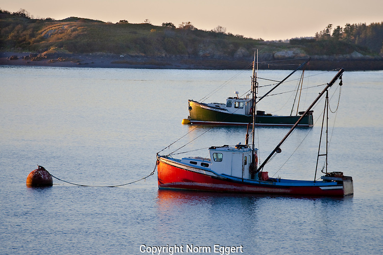 Two Boats Moored in Lubec Harbor, Maine at sunset