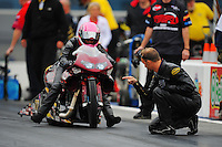 Sept. 16, 2011; Concord, NC, USA: NHRA pro stock motorcycle rider Matt Smith (right) lines up wife Angie Smith during qualifying for the O'Reilly Auto Parts Nationals at zMax Dragway. Mandatory Credit: Mark J. Rebilas-US PRESSWIRE