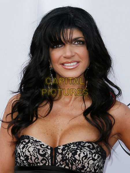 TERESA GIUDICE . arriving at the The Cable Show 2010 To Feature An Evening With NBC Universal held at  Universal Studios Hollywood in Universal City, California, USA, .May 12th, 2010..portrait headshot black lace boobs cleavage .CAP/ROT/AMB.©Adriana M. Barraza /Roth Stock/Capital Pictures