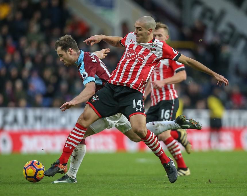 Burnley's Ashley Barnes is tackled by Southampton's Oriol Romeu<br /> <br /> Photographer Alex Dodd/CameraSport<br /> <br /> The Premier League - Burnley v Southampton - Saturday 14th January 2017 - Turf Moor - Burnley<br /> <br /> World Copyright &copy; 2017 CameraSport. All rights reserved. 43 Linden Ave. Countesthorpe. Leicester. England. LE8 5PG - Tel: +44 (0) 116 277 4147 - admin@camerasport.com - www.camerasport.com