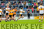 Brian Looney Dr Crokes is pulled back by Greg Horan  Stacks during their County Championship clash in Fitzgerald Stadium on sunday