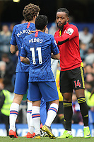 Former Chelsea player, Nathaniel Chalobah of Watford shakes hands with Chelsea's Marcos Alonso and Pedro at the final whistle during Chelsea vs Watford, Premier League Football at Stamford Bridge on 5th May 2019