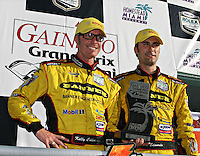 Kelly Collins, left, and Paul Edwards celebrate after winning the Gainsco Grand Prix of Miami Grand Am Rolex Seires sports car race at Homestead-Miami Speedway in Homestead, FL in March of 2008. (Photo by Brian Cleary/www.bcpix.com)