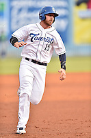 Asheville Tourists first baseman Brian Mundell (15) runs to third during a game against the Lexington Legends at McCormick Field on April 19, 2016 in Asheville, North Carolina. The Legends defeated the Tourists 11-9. (Tony Farlow/Four Seam Images)