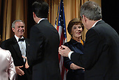 Washington, D.C. - April 29, 2006 -- United States President  George W. Bush and first lady Laura Bush greet guests as they arrive for the White House Correspondents' Association Dinner in Washington on April 29, 2006.  <br /> Credit: Roger L. Wollenberg - Pool via CNP
