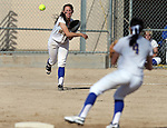 Western Nevada College's Heather Septon makes a throw to Madison Gonzalez in a college softball game against Colorado Northwestern Community College in Carson City, Nev., on Friday, Feb. 22, 2013. .Photo by Cathleen Allison