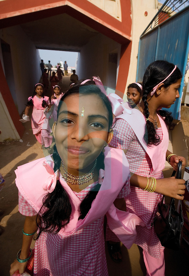 January 26th 2008 _Trivandrum, India _A group of school girls prepare to line up to enter their school bus after attending India Republic Day events at the Central Stadium in Trivandrum, India.  Trivandrum is located in the southern state of Kerala.  Photograph by Daniel J. Groshong/Tayo Photo Group