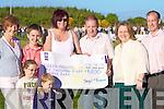 Sean O'Keeffe(2nd left) was presented with his prize winnings last Saturday nigh twho recently won the Gneeveguilla Lottery Jackpot. L-r: May Murphy(ticket seller), Sean O'Keeffe(winner), Brigid O'Riordan(Club Treasurer), Michael O'Keefe, Joanne O'Keefe, Brendan O'Keefe. xxxxx two kids names missing xxxx