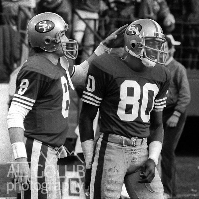 San Francisco 49ers vs Atlanta Falcons  at Candlestick Park Sunday, December 20, 1987..49ers beat Falcons 35-7.San Francisco 49ers Quarterback Steve Young (8) congratulates Wide Receiver Jerry Rice (80)..