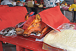 A roasted pig is presented for a meal near Kuala Lumpur, Malaysia.