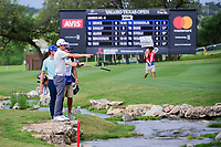 Cameron Smith (USA) and Roberto Castro (USA) look for Smith's ball near the creek on 18 during round 2 of the Valero Texas Open, AT&amp;T Oaks Course, TPC San Antonio, San Antonio, Texas, USA. 4/21/2017.<br /> Picture: Golffile | Ken Murray<br /> <br /> <br /> All photo usage must carry mandatory copyright credit (&copy; Golffile | Ken Murray)
