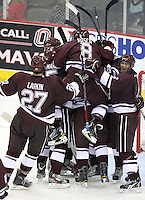 Colgate players celebrate after defeating Nebraska Omaha 4-3 to win the Maverick Stampede. (Photo by Michelle Bishop)