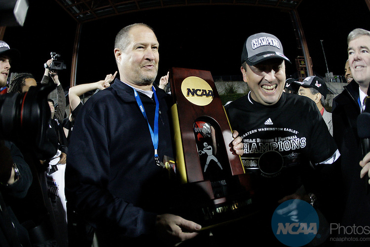 07 JAN 2011:  Chairman of Division I football Jim O'day, left, presents Eastern Washington Eagles head coach Beau Baldwin with the championship trophy after winning the Division l FCS Football Championship held at Pizza Hut Park in Frisco, TX. Eastern Washington defeated Delaware 20-19 for the national title. Donna McWilliam/NCAA Photos