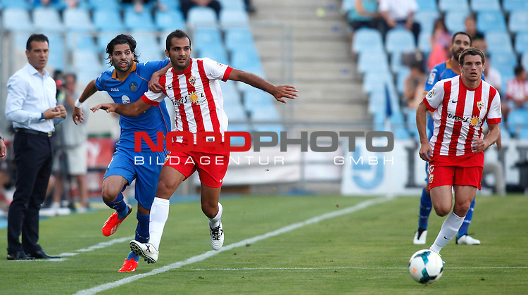 Getafe's Lafita (l) and Almeria's Ruben Suarez (l) and Rodri (r) during La Liga match.August 23,2013. Foto © nph / Victor Blanco)