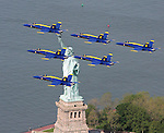The Navy Blue Angels/Air Force Heritage Flight aircraft fly over the Manhattan skyline Thursday, May 25, 2006. Statue of Liberty.  (Photo/Victoria Arocho)