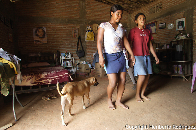 A couple of Afro- Mexicans rehearse the artesa dance of in their San Nicolas home on the coast of Guerrero state, July 6, 2005. Afro- Mexicans are considered one of the three ethnic roots that comprise Mexico. Photo by Heriberto Rodriguez