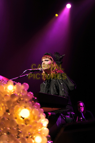 KATE NASH .Performs live during the 'Women Of The World: Equals' live concert to celebrate the 100th anniversary of International Women's Day, Royal Festival Hall, London, England, UK, March 11th 2011..half length concert music gig live on stage black hat side microphone keyboard .CAP/MAR.© Martin Harris/Capital Pictures.
