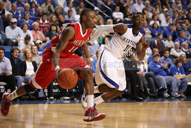 UK Men's Basketball freshman guard John Wall chases down a Miami player in first half of UK's  72-70 win over Miami University at Rupp Arena on Monday, Nov. 16, 2009.  Photo by Britney McIntosh | Staff