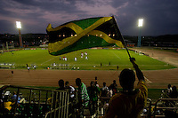 A Jamaican fan waves the flag during the semifinals of the CONCACAF Men's Under 17 Championship at Catherine Hall Stadium in Montego Bay, Jamaica. The United States defeated Jamaica, 2-0.