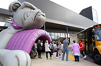 NWA Democrat-Gazette/DAVID GOTTSCHALK Eighth grade students from Woodland Junior High School walk through the inflatable Bulldog Tunnel Tuesday, February 5, 2019, as they arrive at Fayetteville High School for the Bulldog Bash. Students from Woodland High School were greeted by the high school band and spirit squads before participating in an orientation and tour of the campus.