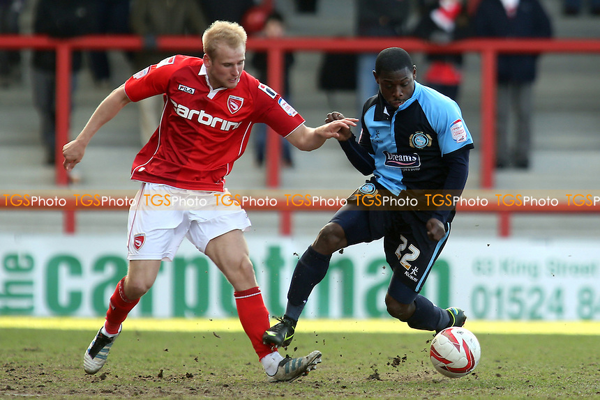 Robbie Threlfall of Morecambe & Wycombe's Joe Kuffour - Morecambe vs Wycombe Wanderers - NPower League Two Football at the Globe Arena, Morecambe - 01/04/13 - MANDATORY CREDIT: Paul Dennis/TGSPHOTO - Self billing applies where appropriate - 0845 094 6026 - contact@tgsphoto.co.uk - NO UNPAID USE.