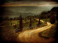 A winding road through the hills of Siena Italy.