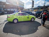 One of the new outer borough taxis is seen on the streets of  the Hell's Kitchen neighborhood in New York on Thursday, October 24, 2013. The new breed of cabs can only pick up street hails in the outer boroughs and in Manhattan north of East 96th Street and West 110th Street. They can take passengers anywhere in the city and the Taxi and Limousine Commission will be issuing a total of 18,000 permits over three years.  (© Richard B. Levine)
