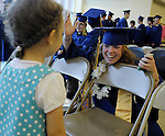 Paige Brokaw of Hebron laughs as she visits with Leena DeRoy, 3 1/2 of Enfield, her mother Nadia is French teacher at RHAM, prior to the RHAM High School graduation ceremony, Tuesday, June 18, 2013, at the school in Hebron.  (Jim Michaud / Journal Inquirer)