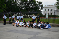 June 25, 2011 (Washington, DC) Twelve people were arrested outside of the White House protesting what they consider unfair treatment of District of Columbia residents. The House Appropriations Committee passed a bill that would prohibit DC from using local tax dollars to provide reproductive healthcare for low-income women.  Many residents feel that Congress too often interferes in local government affairs.  The arrests come just over two months after Mayor Vincent Gray and several city council members were arrested in front of the Dirksen Senate Office Building on April 11, 2011, during a protest opposing congressional oversight of the city's budget. (Photo: Don Baxter/Media Images International)