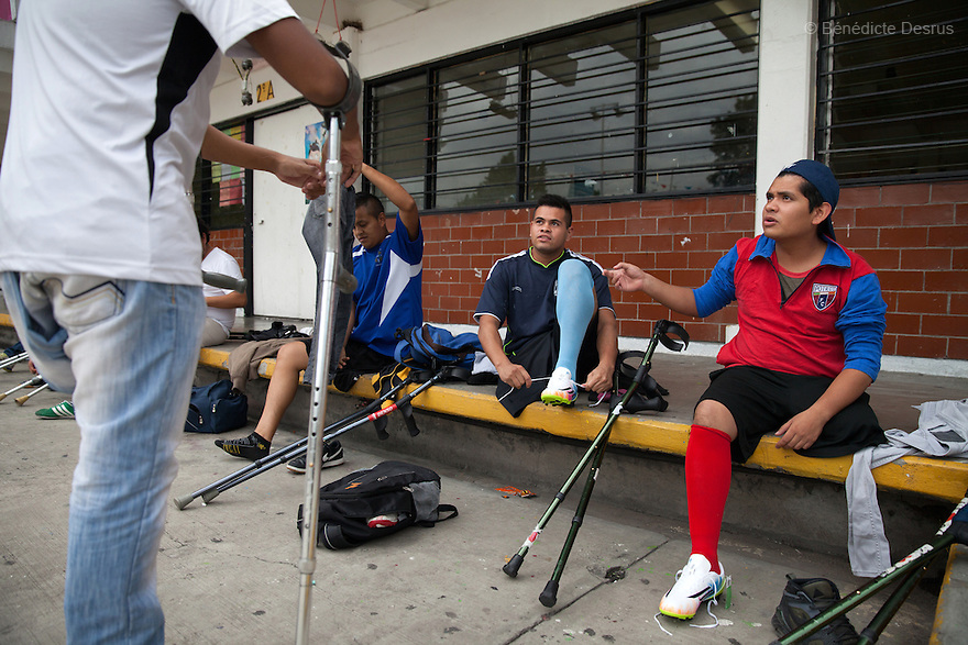 "Players from Guerreros Aztecas, get changed before training in Mexico City, Mexico on June 26, 2014. Guerreros Aztecas (""Aztec Warriors"") is Mexico City's first amputee football team. Founded in July 2013 by five volunteers, they now have 23 players, seven of them have made the national team's shortlist to represent Mexico at this year's Amputee Soccer World Cup in Sinaloa this December. The team trains twice a week for weekend games with other teams. No prostheses are used, so field players missing a lower extremity can only play using crutches. Those missing an upper extremity play as goalkeepers. The teams play six per side with unlimited substitutions. Each half lasts 25 minutes. The causes of the amputations range from accidents to medical interventions – none of which have stopped the Guerreros Aztecas from continuing to play. The players' age, backgrounds and professions cover the full sweep of Mexican society, and they are united by the will to keep their heads held high in a country where discrimination against the disabled remains widespread. (Photo by Bénédicte Desrus)"