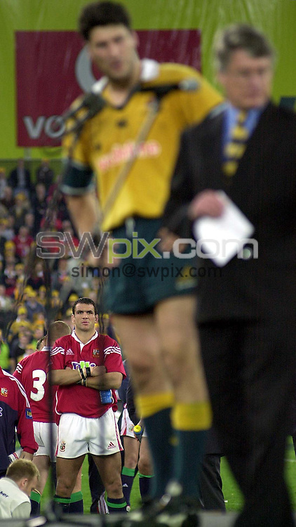 Pix: Ben Duffy.....British and Irish Lions v Australia-3rd Test, Stadium Australia, Sydney, Australia....14/07/2001..COPYWRIGHT PICTURE>>SIMON WILKINSON>>01943 436649>>..Lion's captain Martin Johnson looks on as Australia's captain, John Eales recieves the test trophy