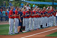 Fort Myers Miracle lineup for the national anthem before a Florida State League game against the Charlotte Stone Crabs on April 6, 2019 at Charlotte Sports Park in Port Charlotte, Florida.  Fort Myers defeated Charlotte 7-4.  (Mike Janes/Four Seam Images)