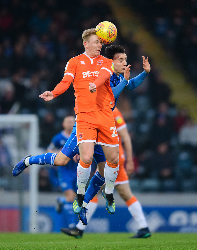 Blackpool's Callum Guy vies for possession with Rochdale's Ollie Rathbone<br /> <br /> Photographer Chris Vaughan/CameraSport<br /> <br /> The EFL Sky Bet League One - Rochdale v Blackpool - Wednesday 26th December 2018 - Spotland Stadium - Rochdale<br /> <br /> World Copyright © 2018 CameraSport. All rights reserved. 43 Linden Ave. Countesthorpe. Leicester. England. LE8 5PG - Tel: +44 (0) 116 277 4147 - admin@camerasport.com - www.camerasport.com