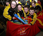 Shauna Campbell, Ciara Butterly, Kevin Ledwith, Aoibheanna Campbell, Ronan Kelly, Mark Byrnes and Seoda Matthews of Dunleer Athletics Club inspect the McDonald's Little Athletic Packs presented to them at McDonalds, Drogheda as part of a Nationwide Programme which is encouraging and providing the resources for children to become involved in grassroots athletics...Photo NEWSFILE/Jenny Matthews.(Photo credit should read Jenny Matthews/NEWSFILE)....This Picture has been sent you under the condtions enclosed by:.Newsfile Ltd..The Studio,.Millmount Abbey,.Drogheda,.Co Meath..Ireland..Tel: +353(0)41-9871240.Fax: +353(0)41-9871260.GSM: +353(0)86-2500958.email: pictures@newsfile.ie.www.newsfile.ie.FTP: 193.120.102.198.