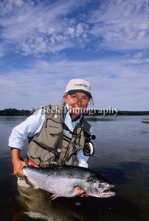 Cathy Beck with a silver salmon, Alaska
