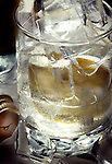 Glass with Gin, ice lemon and tonic water.